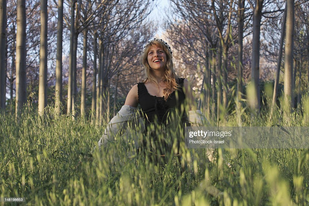 Woman walking in tall grass : Stock Photo
