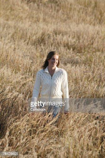woman walking in grass - photo #9