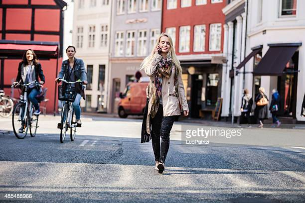 Woman walking in the city talking on the phone