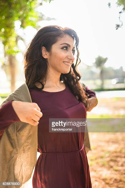 woman walking in the park in abu dhabi - uae
