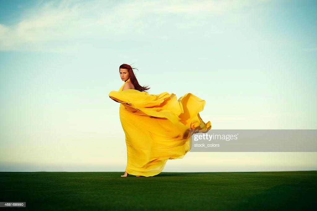 woman walking in the wind