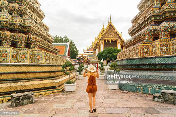 Woman walking in Wat Pho temple