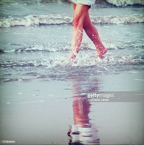 Woman walking in water at seashore