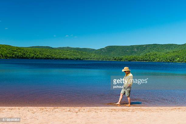 Woman walking in water on beach lake
