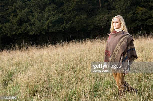 Woman walking in wheatfield