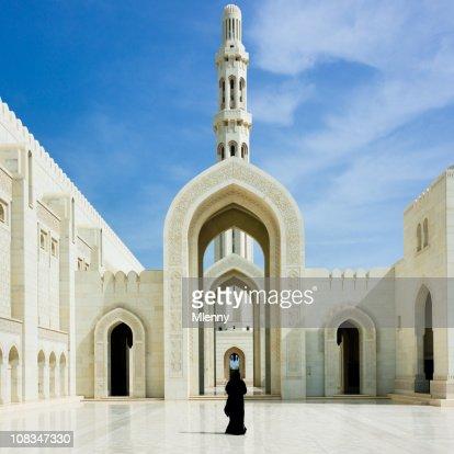 Woman walking inside Sultan Qaboos Grand Mosque Muscat Oman