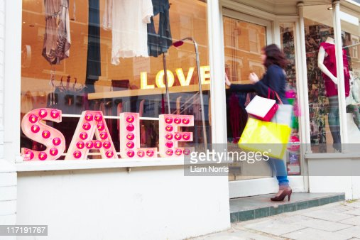 woman walking into a shop