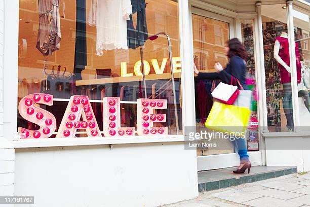 woman walking into a shop