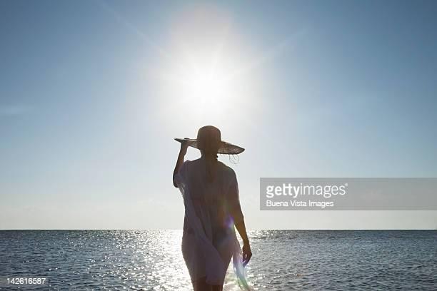 Woman walking into the sea