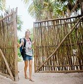 Woman walking into tropical resort