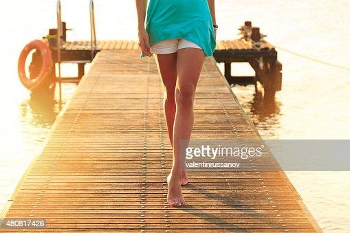 Woman walking on a quay