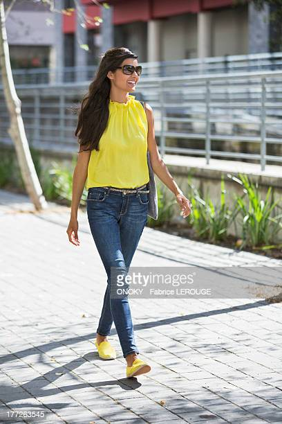 Woman walking on a street and smiling