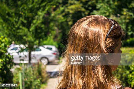 Woman walking on alley : Stock Photo