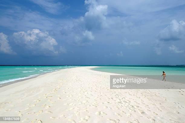 Woman walking on beach, Maldive