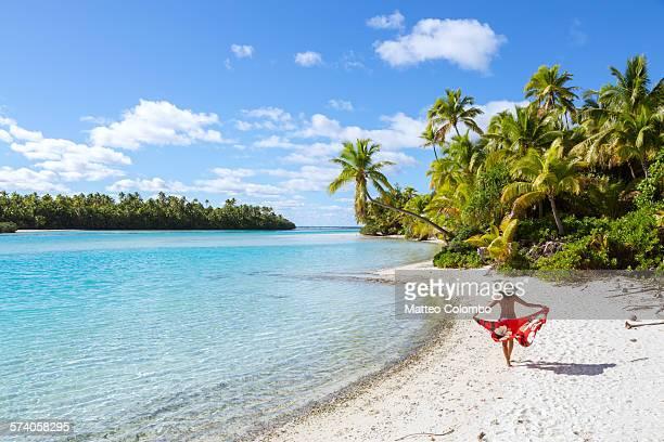 Woman walking on beautiful tropical beach