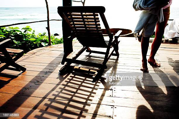 Woman walking on deck overlooking the Caribbean