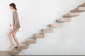 Woman walking on floating staircase