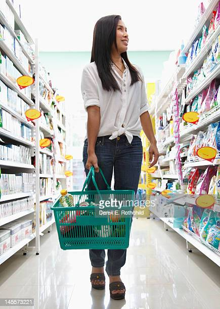 Woman walking on grocery isle