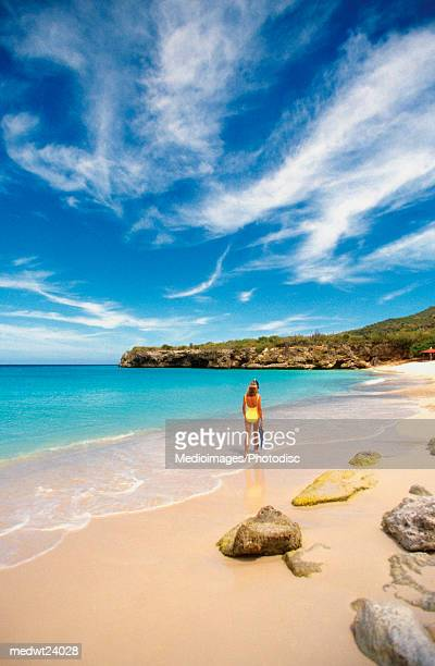 Woman walking on Kniip Beach on Curacao, Caribbean