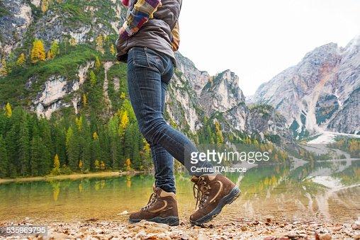 Woman walking on lake braies in south tyrol, italy. Closeup : Stock Photo