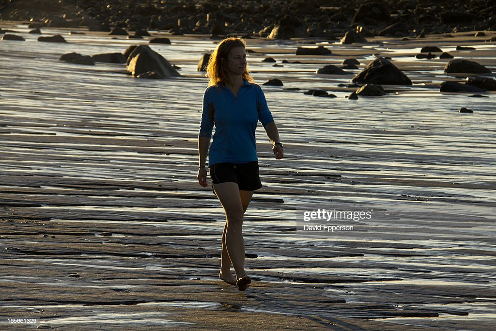 Woman walking on New Zealand beach