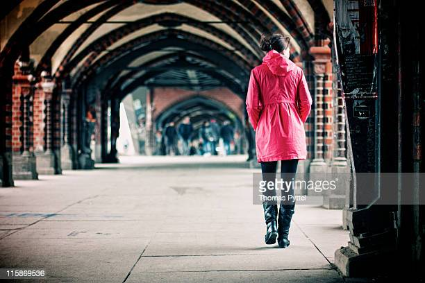 Woman walking on Oberbaum bridge.