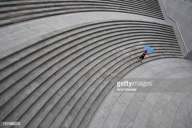 Woman walking on stairs down