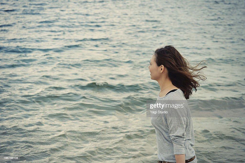 Woman walking on the beach : Stock Photo