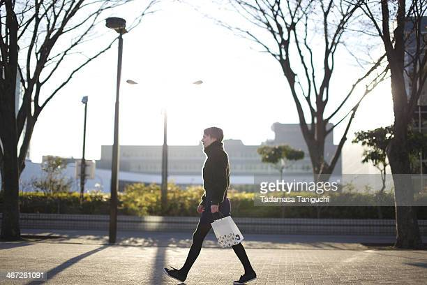 Woman walking on the street