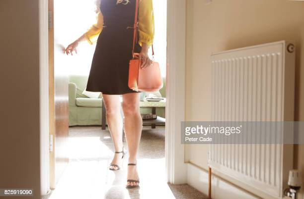 Woman walking out of room, ready to leave house