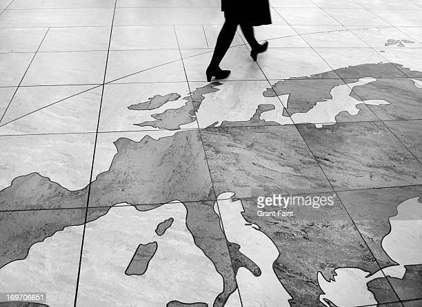 Woman walking over floor map
