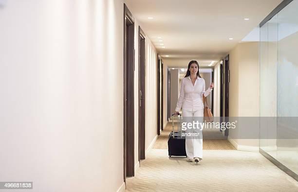 Woman walking through a hotel
