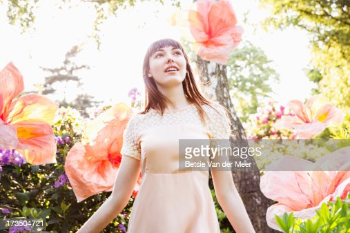 Woman walking through nature with superflowers.