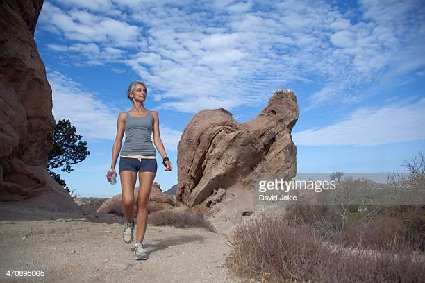 Woman walking through Vazquez Rocks