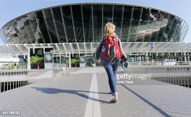 Woman walking towards airport