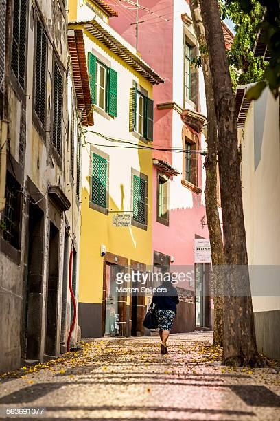 Woman walking up Rua da Concei??o