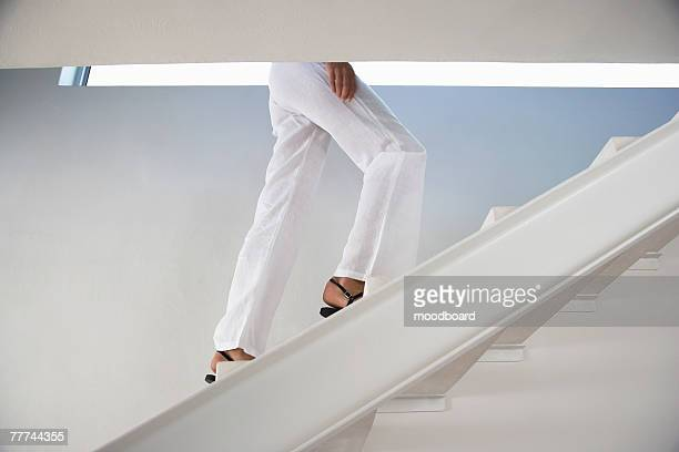 Woman Walking up Steps