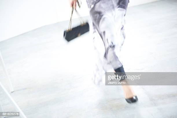 woman walking, wearing long skirt