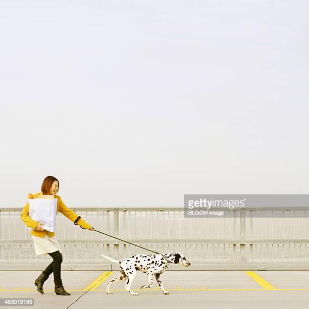 Woman Walking With Dalmatian