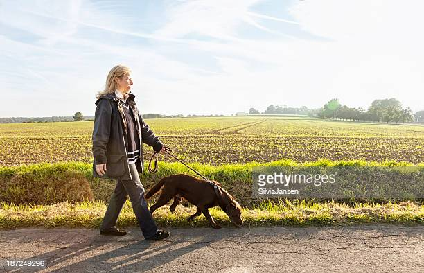 woman walking with dog healthy lifestyle