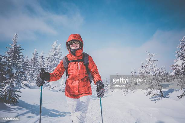 Woman Walking with Snowshoes in Winter Forest Landscape