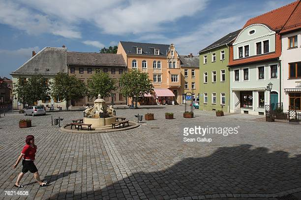 A woman walks across the main market square August 22 2007 in Muegeln Germany A group of approximately 50 youths some of whom yelled 'Foreigners Out'...