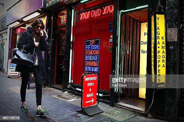 A woman walks along a side street in Soho on January 16 2015 in London England A growing number of campaigners including Stephen Fry are pushing...