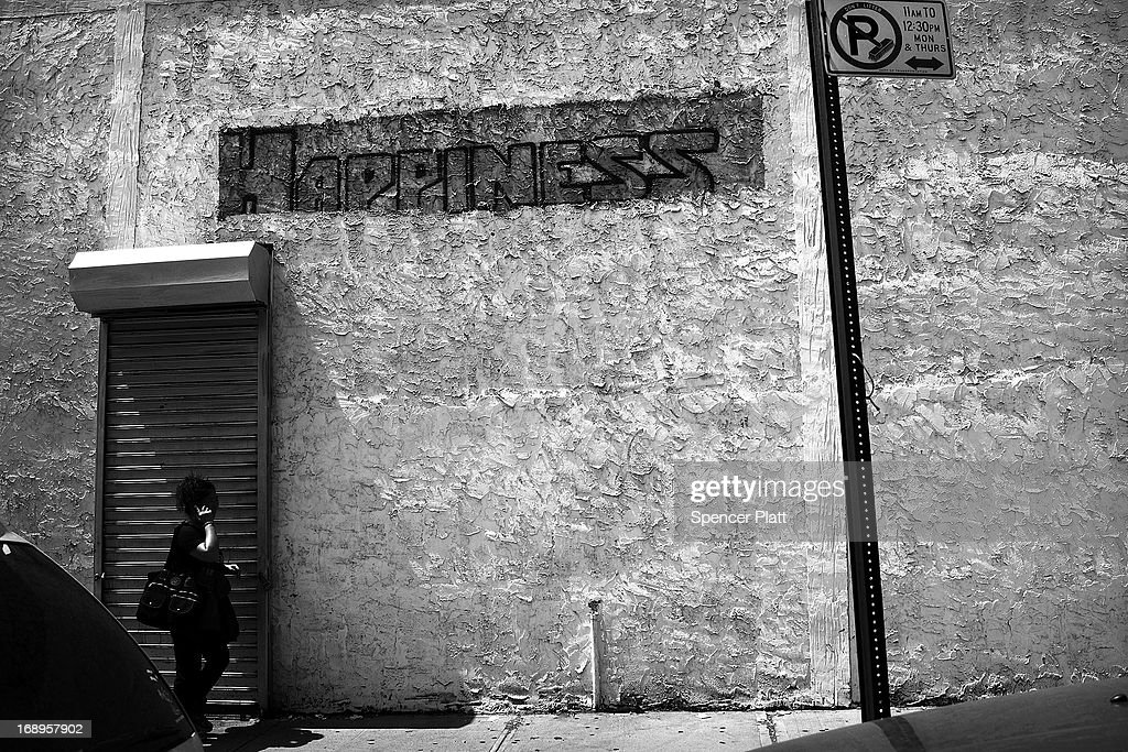 A woman walks along a street near where two people were murdered in 1989 in Bedford-Stuyvesant on May 16, 2013 in Brooklyn borough of New York City. Shabaka Shakur, who was interrogated by New York City Detective Louis Scarcella and is now in his 26th year of a 40-year-to-life sentence for the murders, has maintained his innocence. Following the recent clearing of David Ranta of murder after serving a 23-year prison sentence, the Brooklyn, N.Y. District Attorney is reviewing 50 murder cases investigated by celebrated Detective Louis Scarcella. The review of cases will give special scrutiny to those cases which appear weakest. Scarcella, 61 and now retired, denies ever having used unethical tactics to secure a conviction.