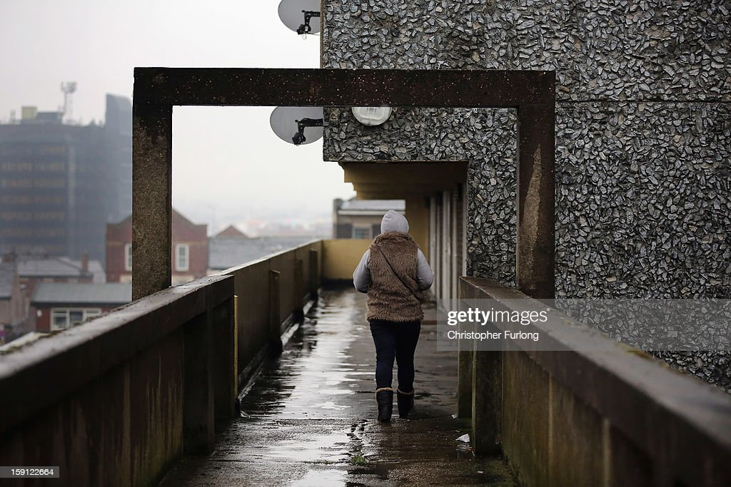 A woman walks along an elevated walkway on the Falinge Estate, which has been surveyed as the most deprived area in England for a fifth year in a row, on January 8, 2013 in Rochdale, England. According to data provided by the Department for Communities and Local Government, 72 per cent of people in the local area are unemployed and seven per cent have never had a job. Four out of five children on the estate are living in poverty, with the area having one of the highest teenage pregnancy rates in the country. During today's House of Commons debate, the government urged MPs to back their planned 1 per cent cap on annual rises in benefits and some tax credits for three years from next April. Benefits for people of working age have historically risen in line with the rate of inflation.