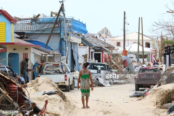 A woman walks along damaged Grande Case Saint Martin days after this Caribbean island sustained extensive damage after the passing of Hurricane Irma...