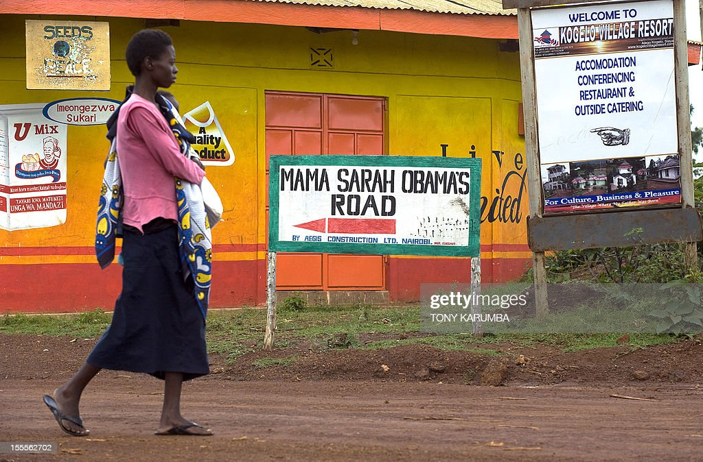 A woman walks along Mama Sarah Obama road, named after US President Barack Obama's step-grandmother Sarah, on November 5, 2012 in the western Kenyan hamlet of Kogelo a day before US elections. Obama's father was born in Kogelo. AFP PHOTO/Tony KARUMBA