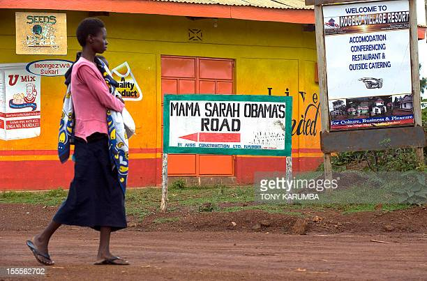A woman walks along Mama Sarah Obama road named after US President Barack Obama's stepgrandmother Sarah on November 5 2012 in the western Kenyan...