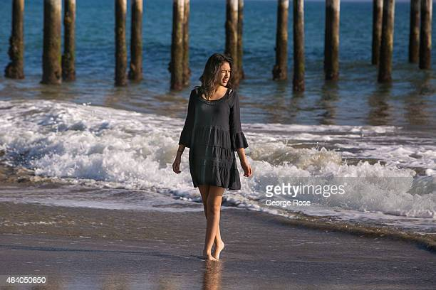 A woman walks along the beach at Gaviota State Beach at low tide on February 16 near Santa Barbara California Because of its close proximity to...