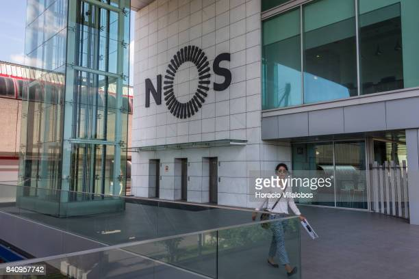 A woman walks at the headquarters of Portuguese 'NOS Comunicacoes' a GSM/UMTS/LTE mobile operator on August 30 2017 in Lisbon Portugal Isabel dos...